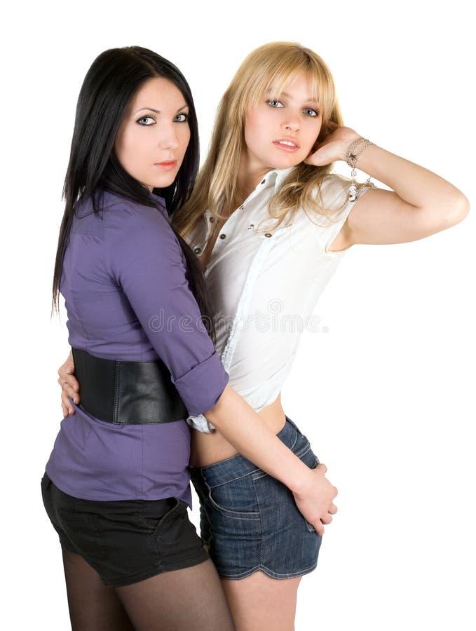Zwei reizvolle junge Freundinnen lizenzfreies stockfoto