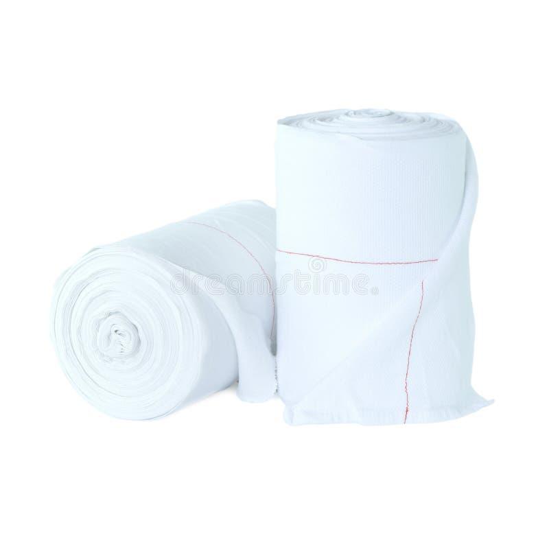 Zwei Rollen von ununterbrochenen Tüchern des weißen Stoffes stockfoto