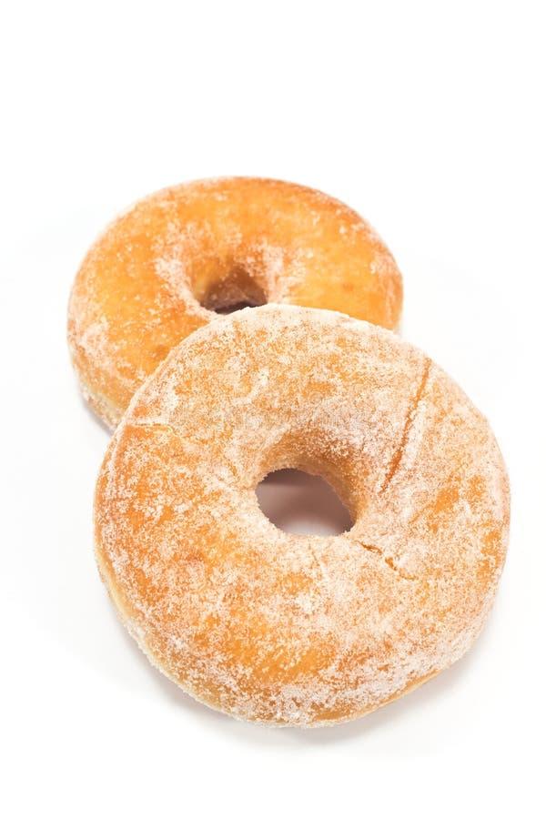 Zwei Schaumgummiringe pulverisiert mit Zucker lizenzfreies stockbild