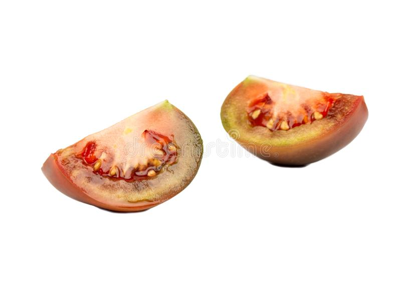 Zwei Scheiben kumato Tomate stockfotografie