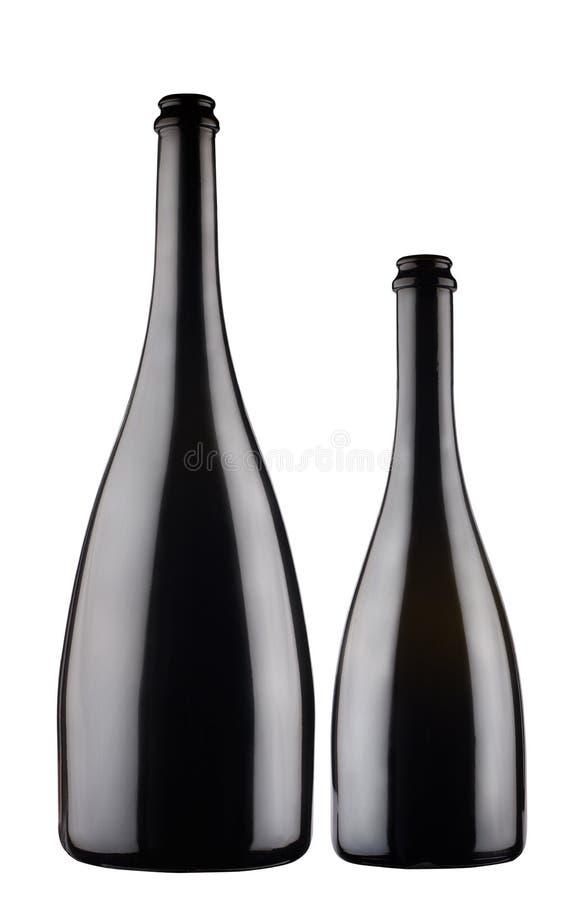 Zwei schwarze Sektflaschen auf grauem Hintergrund lizenzfreie stockfotografie