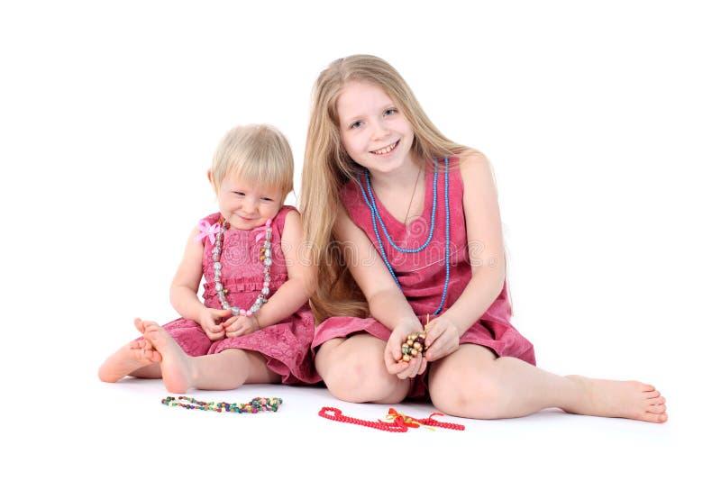 zwei Schwestern 9-jährig und einjährig lizenzfreies stockbild