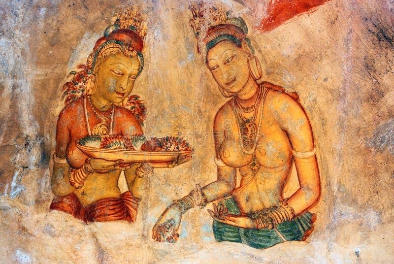 Zwei Sigiriya Maid mit Früchten: ein des 5. Cers lizenzfreie stockfotos