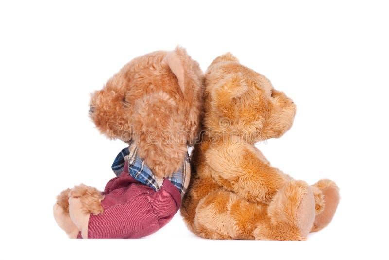 Zwei Teddybären, sitzend zurück zu Rückseite stockbilder