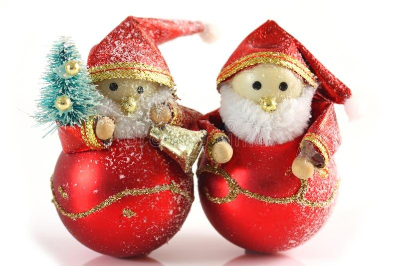 Zwei Vater-Weihnachtsabbildungen lizenzfreie stockfotos