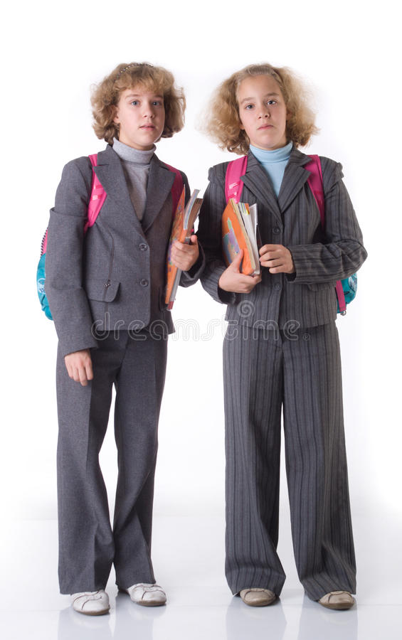 Zwei Zwillinge mit Lehrbuch stockbilder