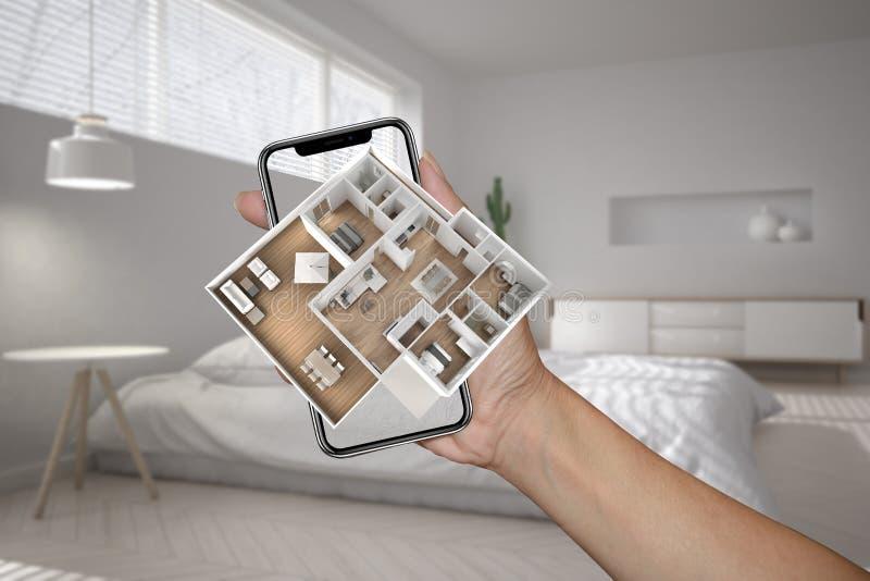 Zwiększający rzeczywistości pojęcie Ręki mienia smartphone z AR zastosowaniem używać symulować 3d wystrzału domu interaktywne map fotografia stock