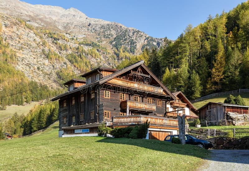 Traditional wooden apartment house surrounded by the Alps. Village Zwieselstein, state of Tyrol, Austria royalty free stock image