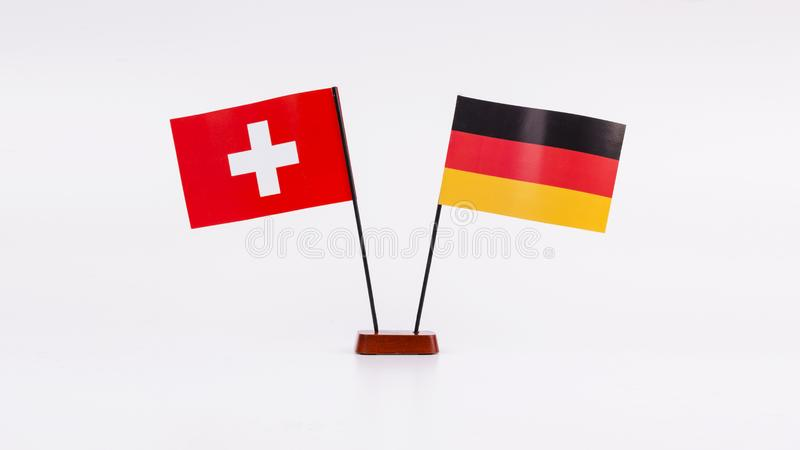 Zwitserland en de Diplomatie en de Vlaggen van Duitsland royalty-vrije stock afbeelding