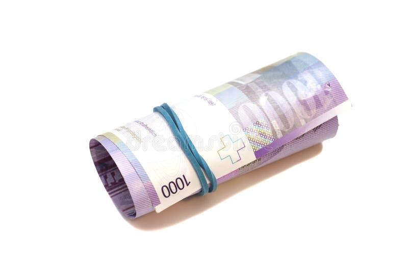 Zwitserse duizend franken in een broodje stock foto