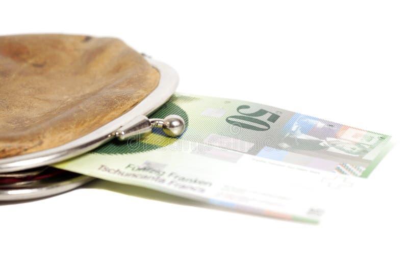 Zwitserse vijftig franken in portefeuille die op wit wordt geïsoleerd stock afbeelding