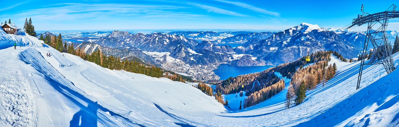 Zwolferhorn mount in snow, St Gilden, Salzkammergut, Austria. Panorama of the snowbound slope of Zwolferhorn mount with hundreds of fine pistes, Wolfgangsee lake stock photos