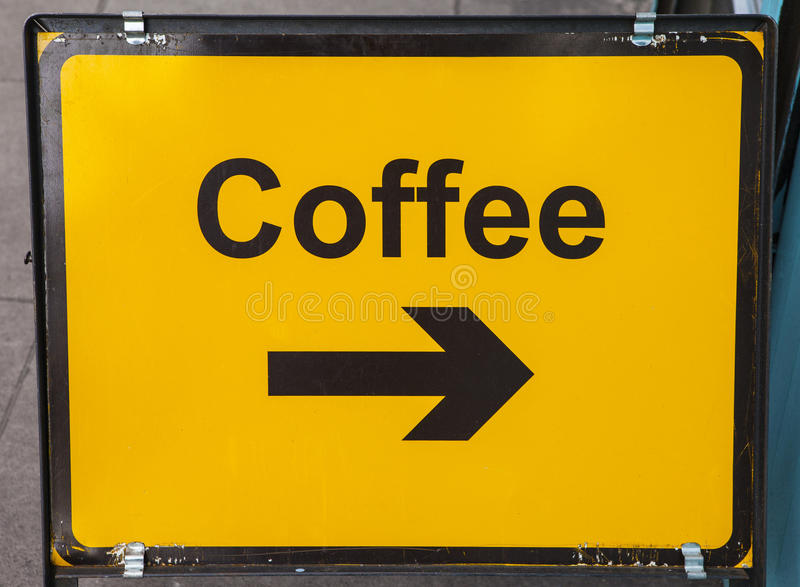 Zwrot prawica dla kawy fotografia stock