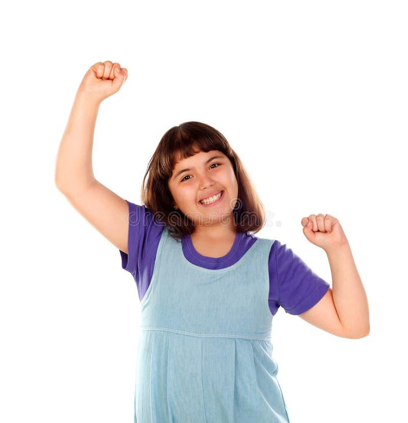 Zwycięzca dziewczyny odświętność coś i dźwiganie ona ręki fotografia stock