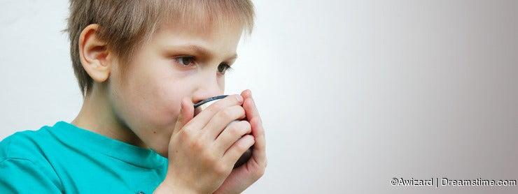 Sad boy with hot drink,