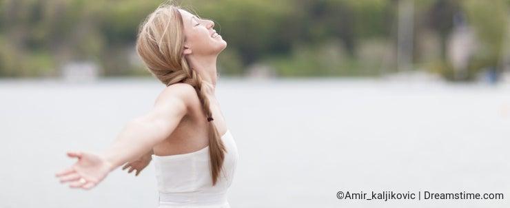 Woman taking deep breath