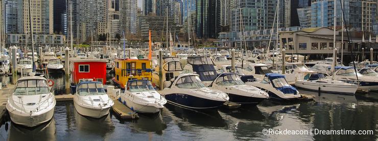 Yachts in front of wealthy Residential Apartments