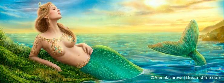 Beautiful princess- fantasy mermaid at sunset background