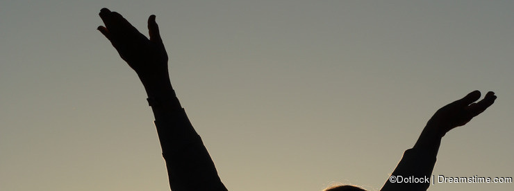Senior woman lifting hands to sky