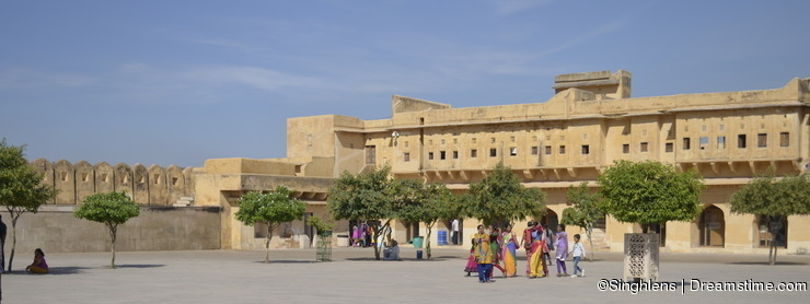 Jaipur, Rajasthan, India: Majestic courtyard of Amber Fort in Jaipur, tourists enjoying the architecture of the palace
