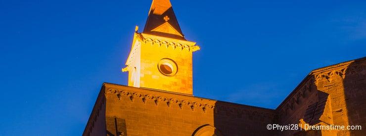 Monastery apse illuminated evening view