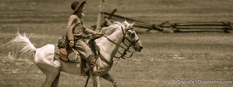 Civil war reenactor on horseback