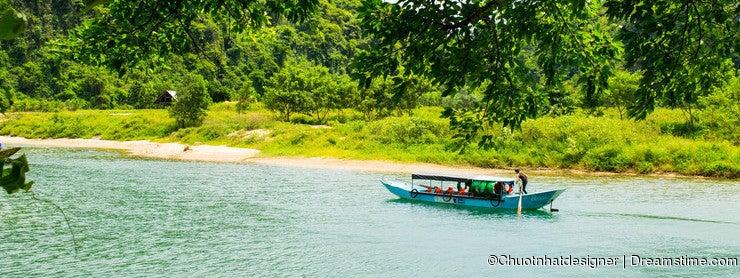 Tourist boats, the mouth of Phong Nha cave with underground river, Phong Nha-Ke Bang National Park, Vietnam