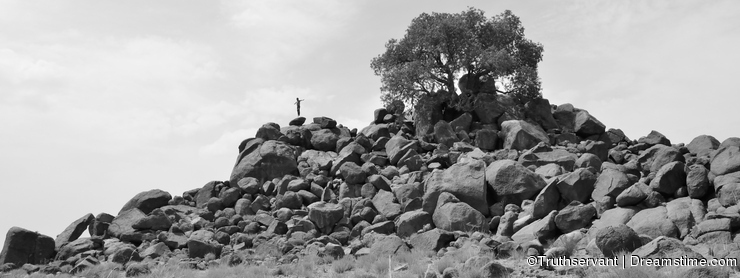 Man doing levitation on rocks -B&W-