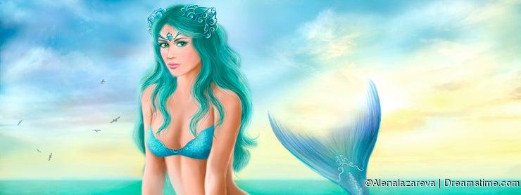 Fantasy beautiful young woman mermaid in sea