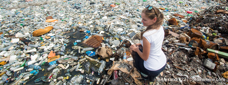 Girl sitting near lake covered with plastic bottles