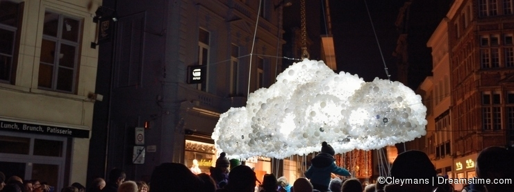 Crowd watching Light bulbs in the shape of a cloud