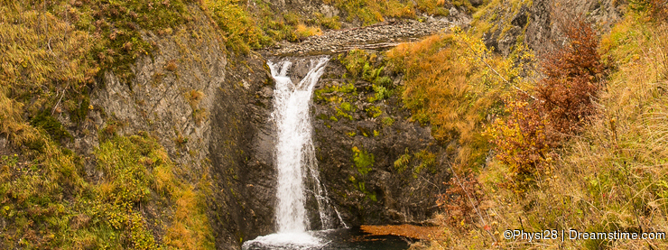 Waterfall in the autumnal Pyrenees mountains