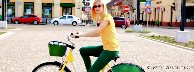 Blonde Woman With Glasses on Bicycle