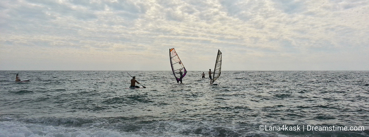 Surfing on the Black Sea, waves and clouds, seacoast Sochi