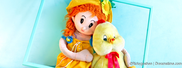 Doll and a baby chick