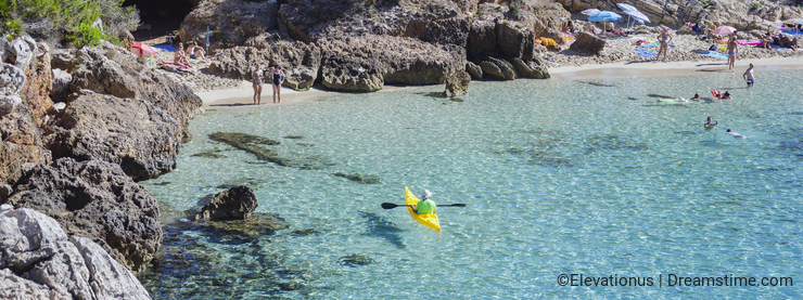 People enjoy a sunny day at Cala Gat in Mallorca, Spain