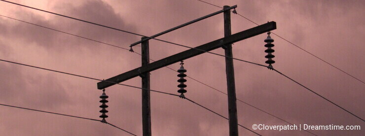 Power Lines Against a Stormy Sunset