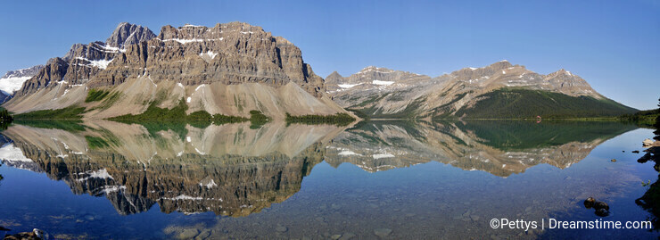 Bow Lake - Mountains reflected on the surface. Panorama