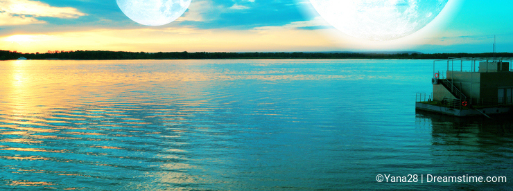 Surreal sunset over river with two Moons