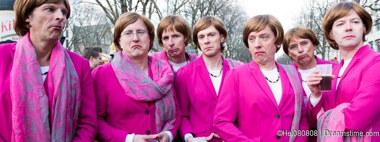 Group of young men posing as Angela Merkel