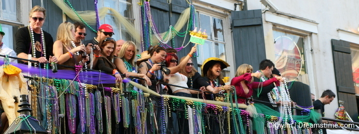 People celebrated crazily in Mardi Gras parade.
