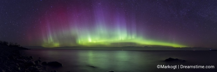 Aurora Borealis panorama and beautiful reflections