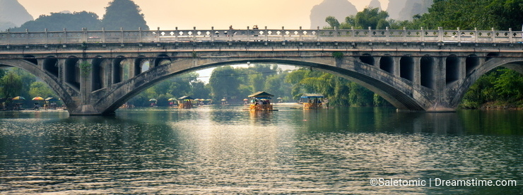YANGSHUO, CHINA - SEPTEMBER 23, 2016: Boats with tourists floati