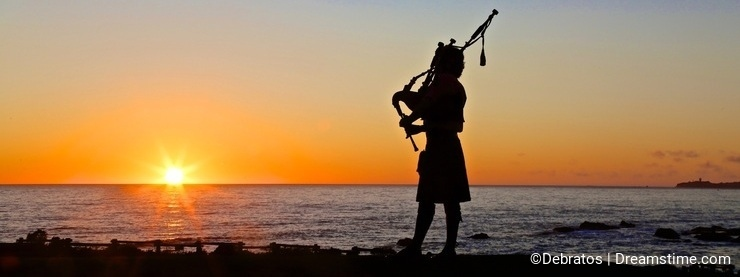 sunset silhouette bagpipe player