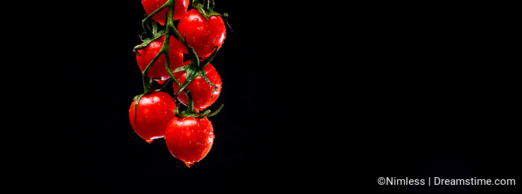 Grape of wet cherry tomatoes levitating