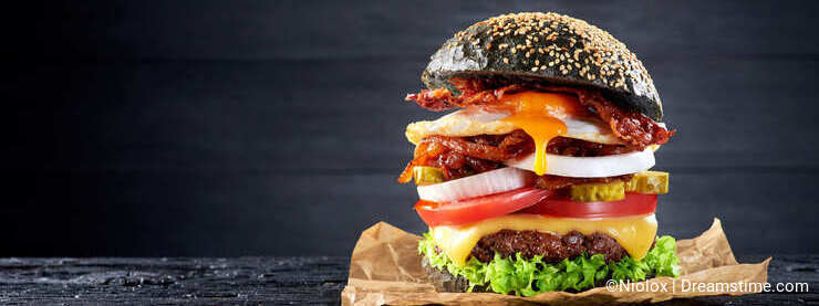 Black burger with egg and bacon