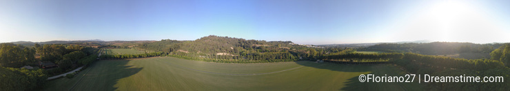 Aerial 360 degrees panorama over hills and polo fields at sunset