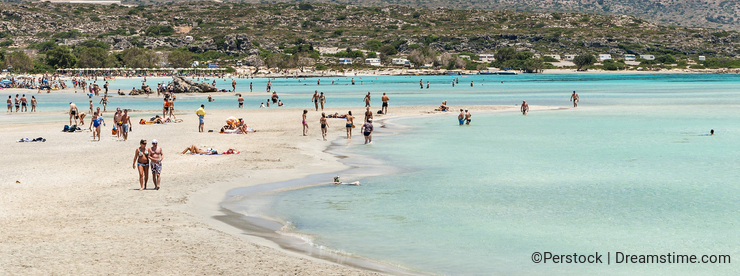 Sandbeach with people on Elafonisi Crete