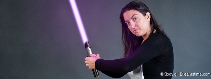 Woman holding lightsabre