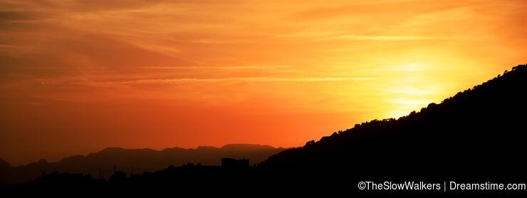 Sunset behind Spanish hills.